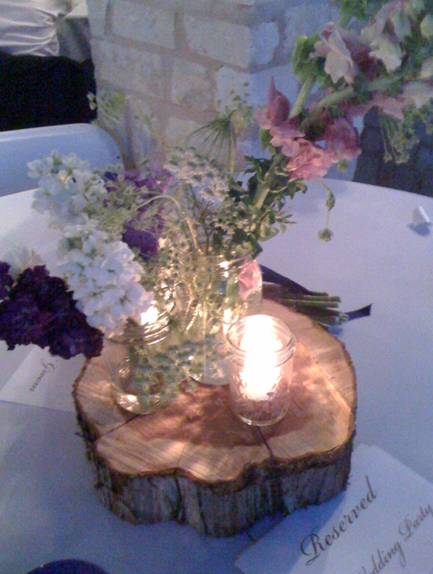 Wildflowers candles and wood cuts created rustic centerpieces